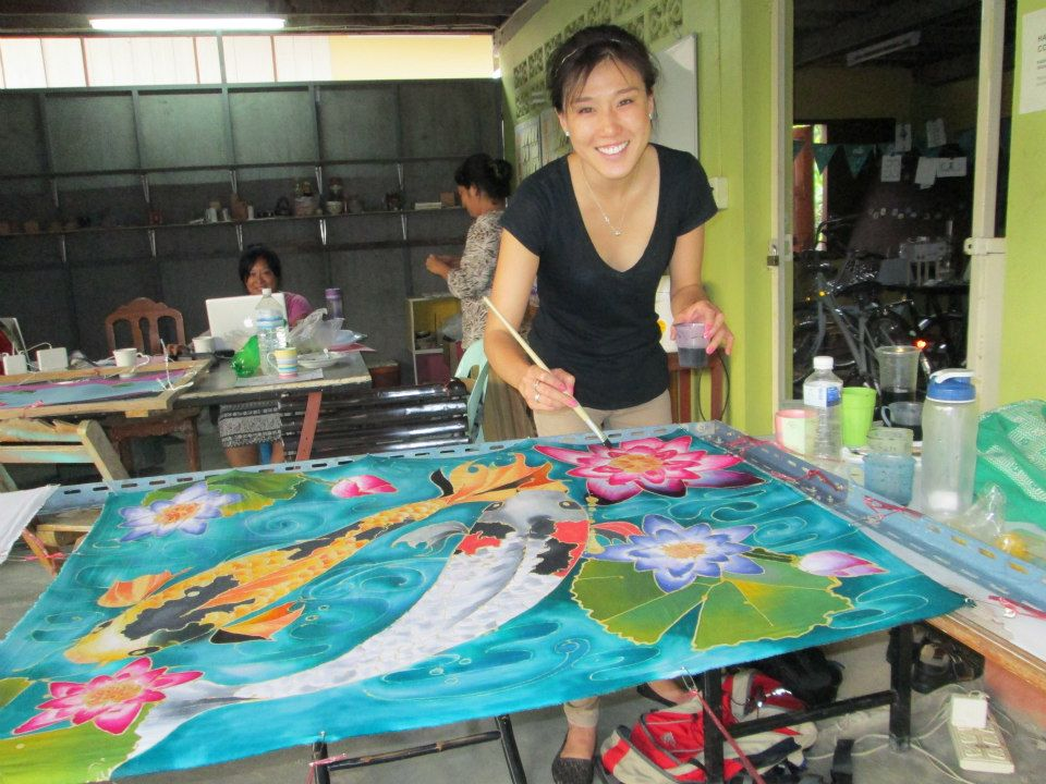"Kendra doing ""batik"" (traditional silk dying/painting) while living in Thailand last year."